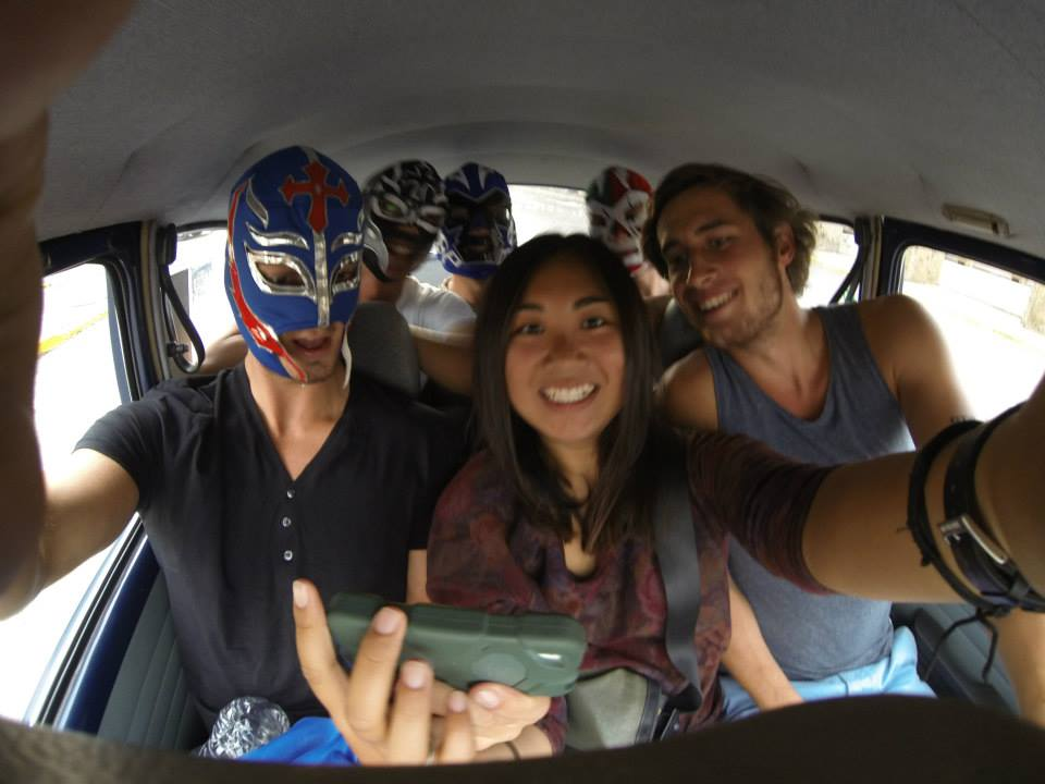 Six people squeezed into a tiny beetle with me sitting on the gear box. The guys are pretty stoked to hit up the lucha libre