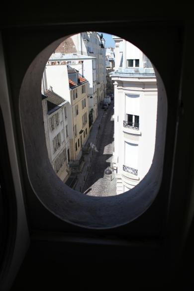 My porthole window in my Latin Quarter apartment