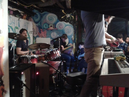 Setting up mics for the band at remote shoot, WXWC