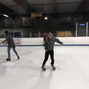 Pretending to enjoy myself Ice skating when really dying inside