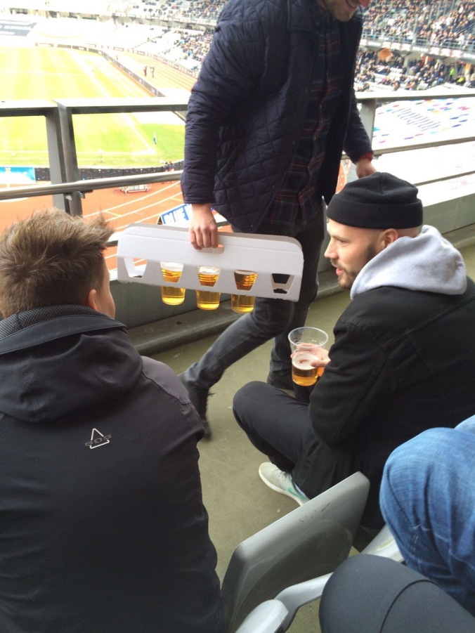 Beer and all black aesthetic at the football